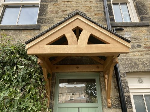 Solid oak porch canopy by TF Building and Renovations